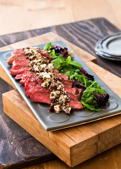 Beef tenderloin with goat cheese sun dried tomato and caper topping